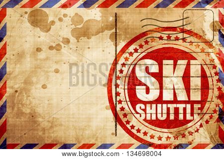 ski shuttle, red grunge stamp on an airmail background