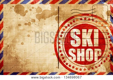 ski shop, red grunge stamp on an airmail background