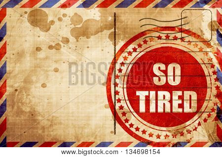so tired, red grunge stamp on an airmail background
