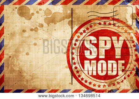 spy mode, red grunge stamp on an airmail background