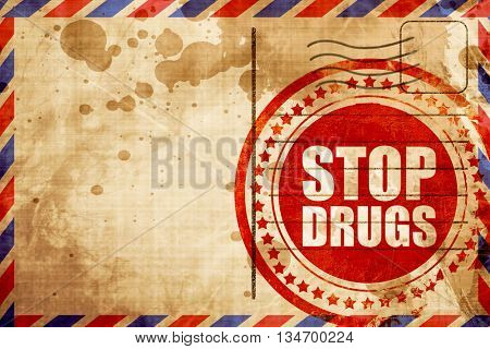 stop drugs, red grunge stamp on an airmail background
