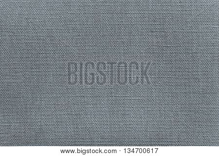 surface of rough fabric or textile material for the textured wallpaper and for a background of monochrome gray silvery color