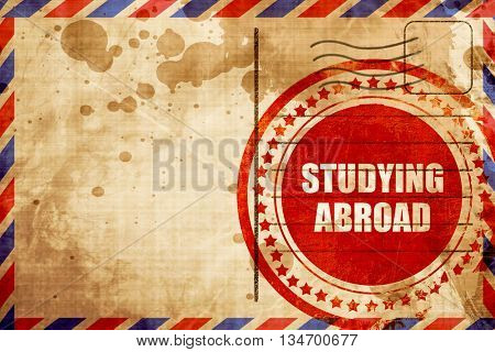 studying abroad, red grunge stamp on an airmail background
