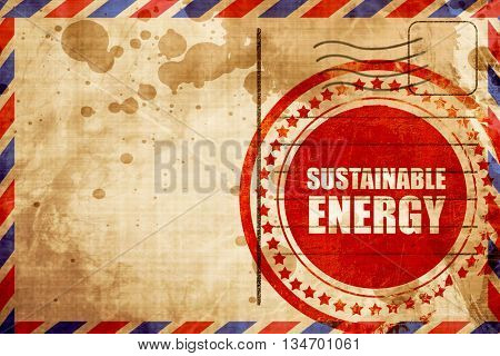 sustainable energy, red grunge stamp on an airmail background