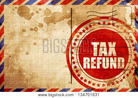 tax refund, red grunge stamp on an airmail background