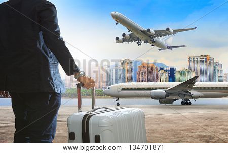 jet plane flying over runways and beautiful dusky sky with copy space use for air transport journey and traveling industry business