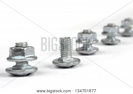 Set of bolts and nuts on the white background.