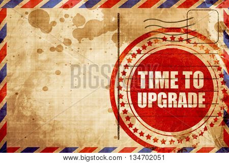 time to upgrade, red grunge stamp on an airmail background