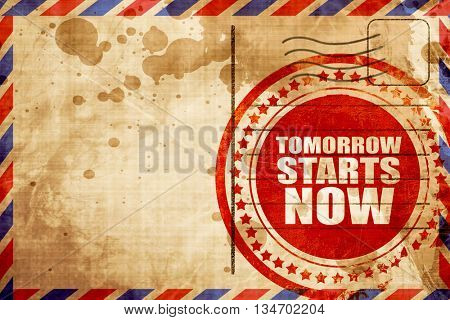 tomorrow starts now, red grunge stamp on an airmail background