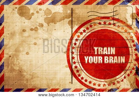 train your brain, red grunge stamp on an airmail background