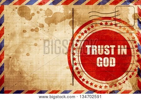 trust in god, red grunge stamp on an airmail background