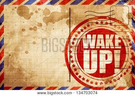 wake up, red grunge stamp on an airmail background