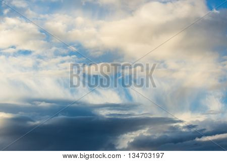Cloudscape in blue sky and rain during storm