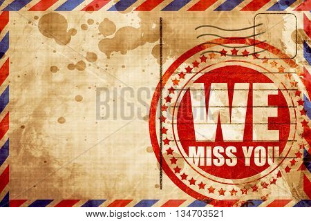 we miss you, red grunge stamp on an airmail background
