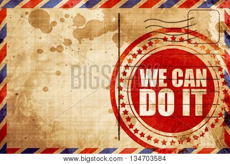 we can do it, red grunge stamp on an airmail background