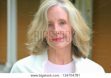 Mature female blond beauty fashion model expressions outside