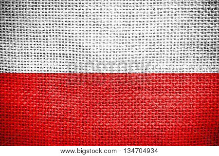 Texture of sackcloth with the image of the Poland flag