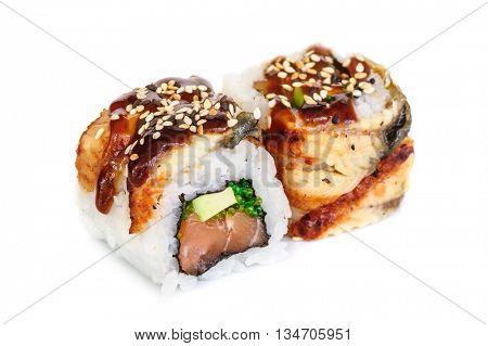 Uramaki maki sushi, two rolls isolated on white. Eeel with philadelphia, avocado, sesame and green tobico