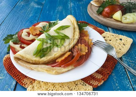 omelette with fresh vegetables, a dish of eggs, tomatoes and pepper