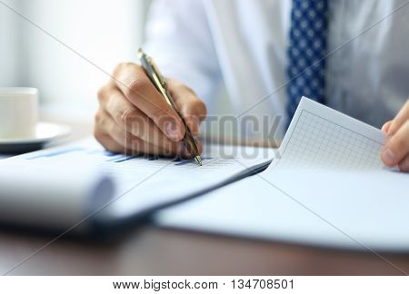 Businessman taking business notes at his office