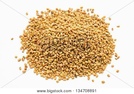 The Fenugreek seeds spices on white background.