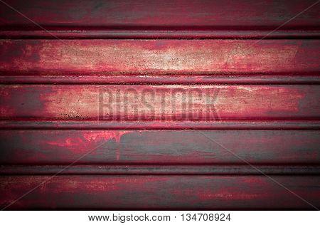 Close-up metallic pattern of rusty red gate
