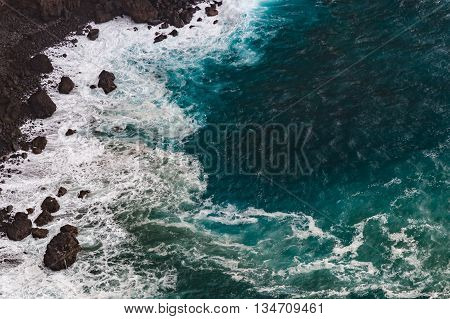 Danger rocky coast stormy weather with large waves from above view