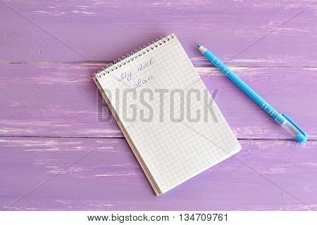 Open paper notebook with message My diet plan. Notepad to plan weight loss. Blue pen. Planning concept