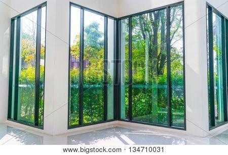 Glass window overlooking green garden