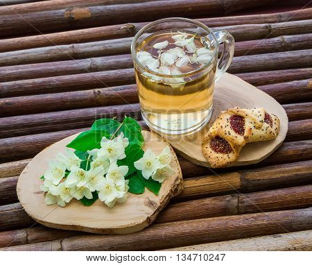 Jasmine tea cookies and jasmine flowers on vintage wooden table