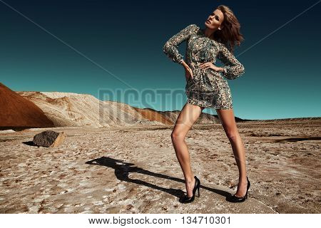 Beautiful adult girl in dress. Salty desert.