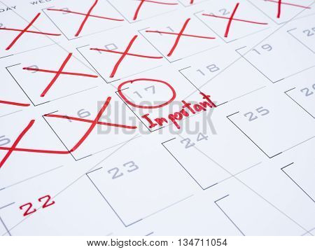 Handwriting word important and pen on calendar desk with red ink 1