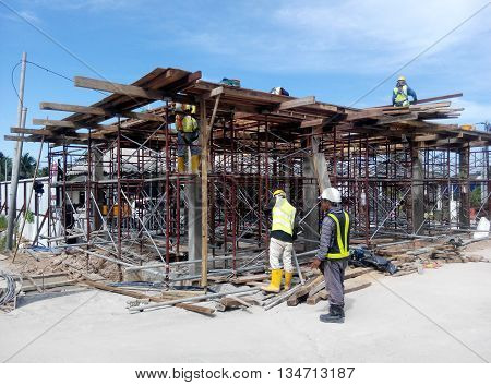 PERAK, MALAYSIA -APRIL 10, 2016: Construction workers fabricating timber form work mostly using plywood at the construction site in Perak, Malaysia.
