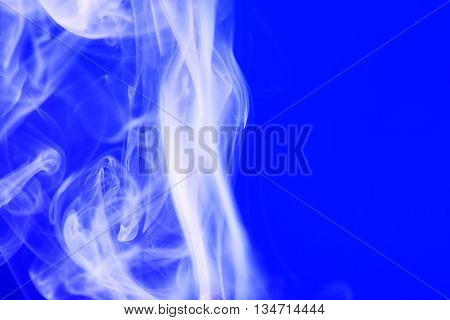Abstract background with smoke on blue with free space for text