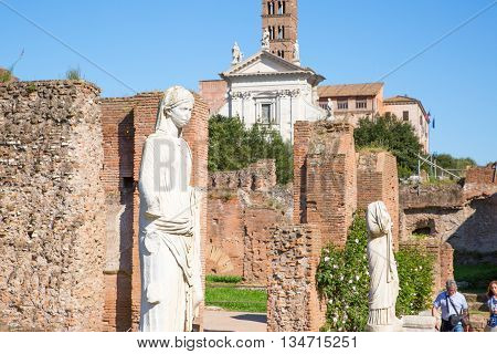 ROME, ITALY - APRIL 8, 2016: Sculptures of Goddess at Roman's forum. Roman's forum with ruins of important ancient government buildings started 7th century BC