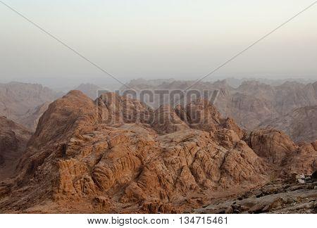 Orange Mount Sinai in early morning with fog