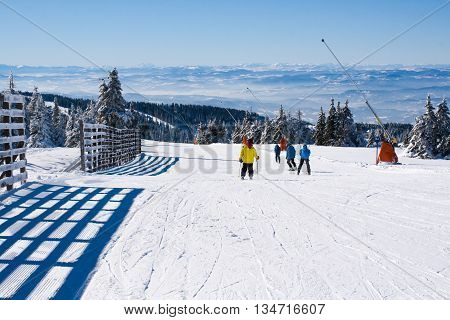Kopaonik, Serbia - January 20, 2016: Ski resort Kopaonik, Serbia, people skiing down the hill, mountains view