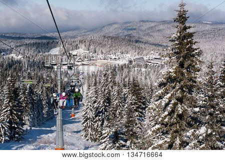 Kopaonik, Serbia - January 22, 2016: Ski resort Kopaonik, Serbia, people on the ski lift, mountains houses and buildings panorama