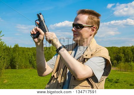 The man shooting from the sports gun outdoors