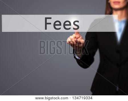 Fees - Businesswoman Hand Pressing Button On Touch Screen Interface.