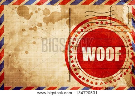 woof, red grunge stamp on an airmail background