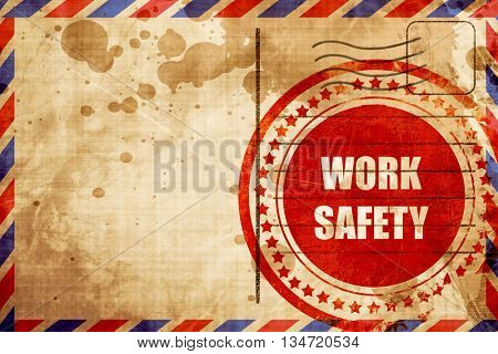 Work safety sign, red grunge stamp on an airmail background