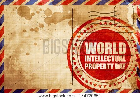 world intellectual property day, red grunge stamp on an airmail