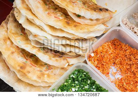 Grilled crispy puff with minced pork, egg and vegetables, Vietnamese street food in Ho Chi Minh city.