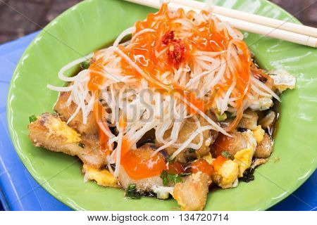 'Bot Chien' Fried rice flour cake with eggs, Vietnamese street food in Ho Chi Minh city.