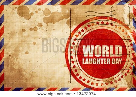 world laughter day, red grunge stamp on an airmail background