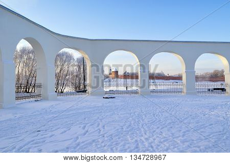 Winter architecture landscape - architecture landmarks towers of Novgorod Kremlin fortress in the arches of ancient arcade of Yaroslav Courtyard in Veliky Novgorod Russia winter architecture view