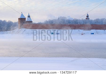 Architecture landscape - winter panoramic view of Novgorod architecture - Kremlin towers near the Volkhov river among the cold mist in Veliky Novgorod Russia architecture landmark