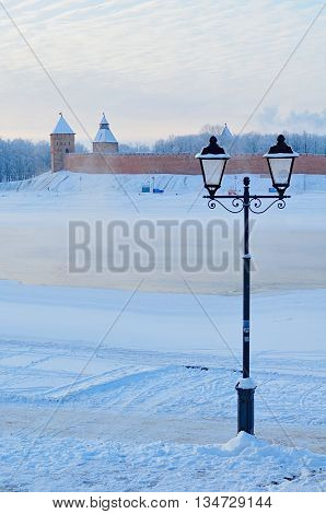 Winter architecture view of Novgorod Kremlin near the Volkhov river among the cold mist - architecture landmark. Focus at the towers. Architecture landscape of Veliky Novgorod architecture Russia.