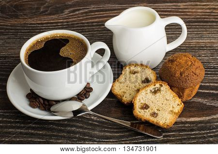 Hot Coffee, Jug Milk And Muffins On Dark Table